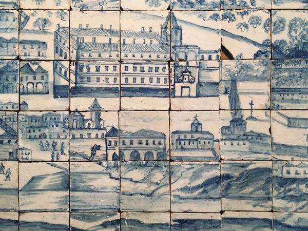 Photograph of tiles painted with images of old buildings